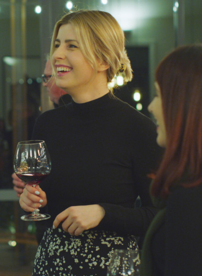Young professional woman at corporate retreat holding wine