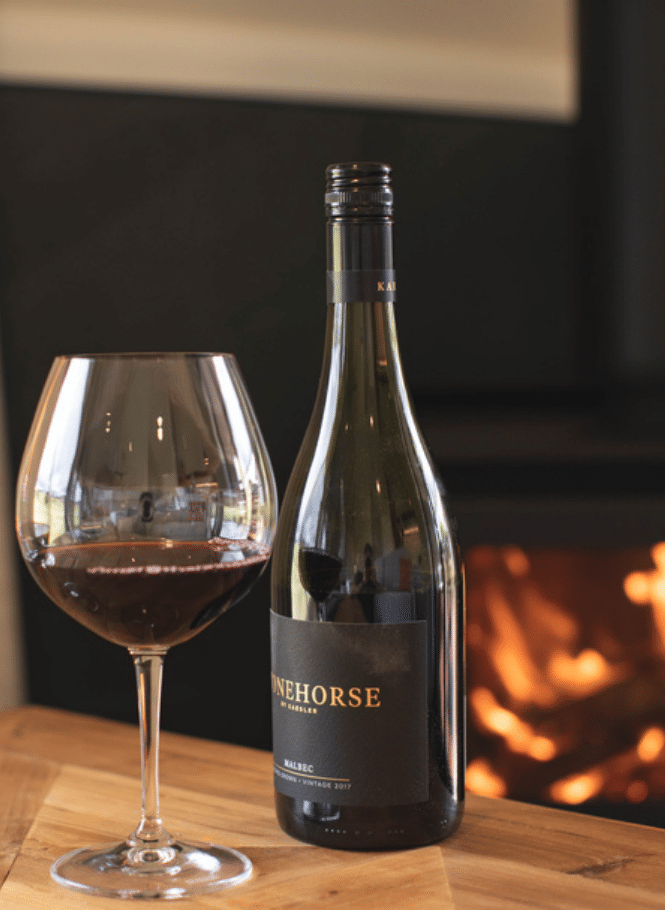Red wine in front of fire, Luxury Pavilion at Hazelwood Estate