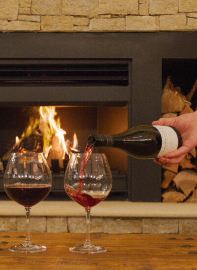 Red wine in front of roaring fire The Paddock Restaurant, Scenic Rim