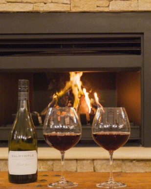 Red wine in front of fire at Hazelwood Estate