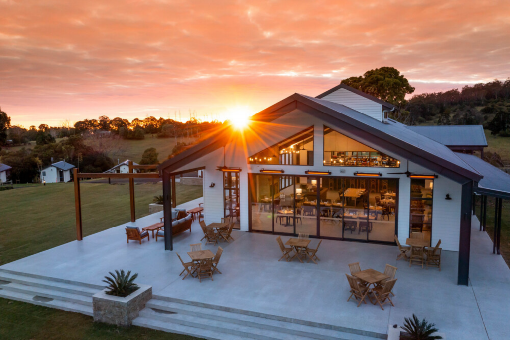 The Club House Exterior with beautiful pink sunset